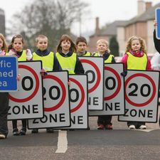 Edinburgh mixes physical road treatment measures to enforce residential 20 mph zones and temporary signals and controlled crossings to limit speeds near schools