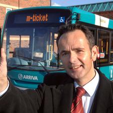 Arriva Bus UK's Mike Cooper celebrates 2m m-ticket sale