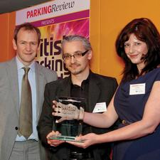 Mark Sloane of Birmingham Urban Design receives the trophy from category sponsor Kimberley Bailey of SIX Card Solutions