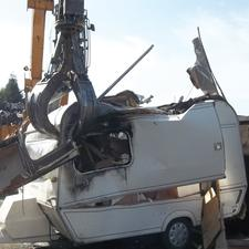 A caravan being crushed by the city council
