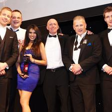 The Marston team with awards host Al Murray