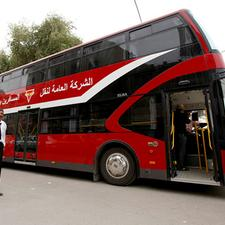 One of Baghdad's new Elba House Jordanian-built double deckers and the Yutong Chinese built model in Skopje.