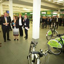 Norman Baker is shown the citycard cycle scheme and launches an electric bus. Alongside is the Nottingham portfolio holder for planning and transportation, Jane Urquhart