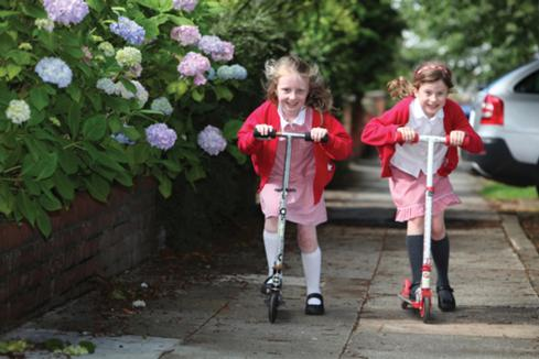 Millie and Charlotte scooting to school in Darlington (photo Darlington Borough Council)