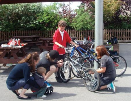 Pupils and parents at a  Dr Bike session at Camden Primary school in Sutton