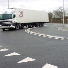 Plastic lane dividers are one feature of the roundabout design