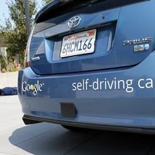 How will driverless cars integrate into the world of human beings?