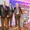 Manny Rasores (jury member), Marcus Brodin (FES) and Tim Duke (NCP) with Ade Adepitan