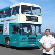 Arriva driver Matthew Evans who arranged for a farewell run in one of the buses which he stands beside