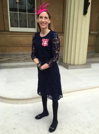 Helen Dolphin receives her MBE from Prince Charles