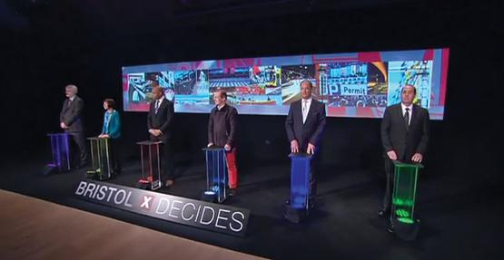 George Ferguson, in customary red trousers, flanked by the other five candidates (BBC)