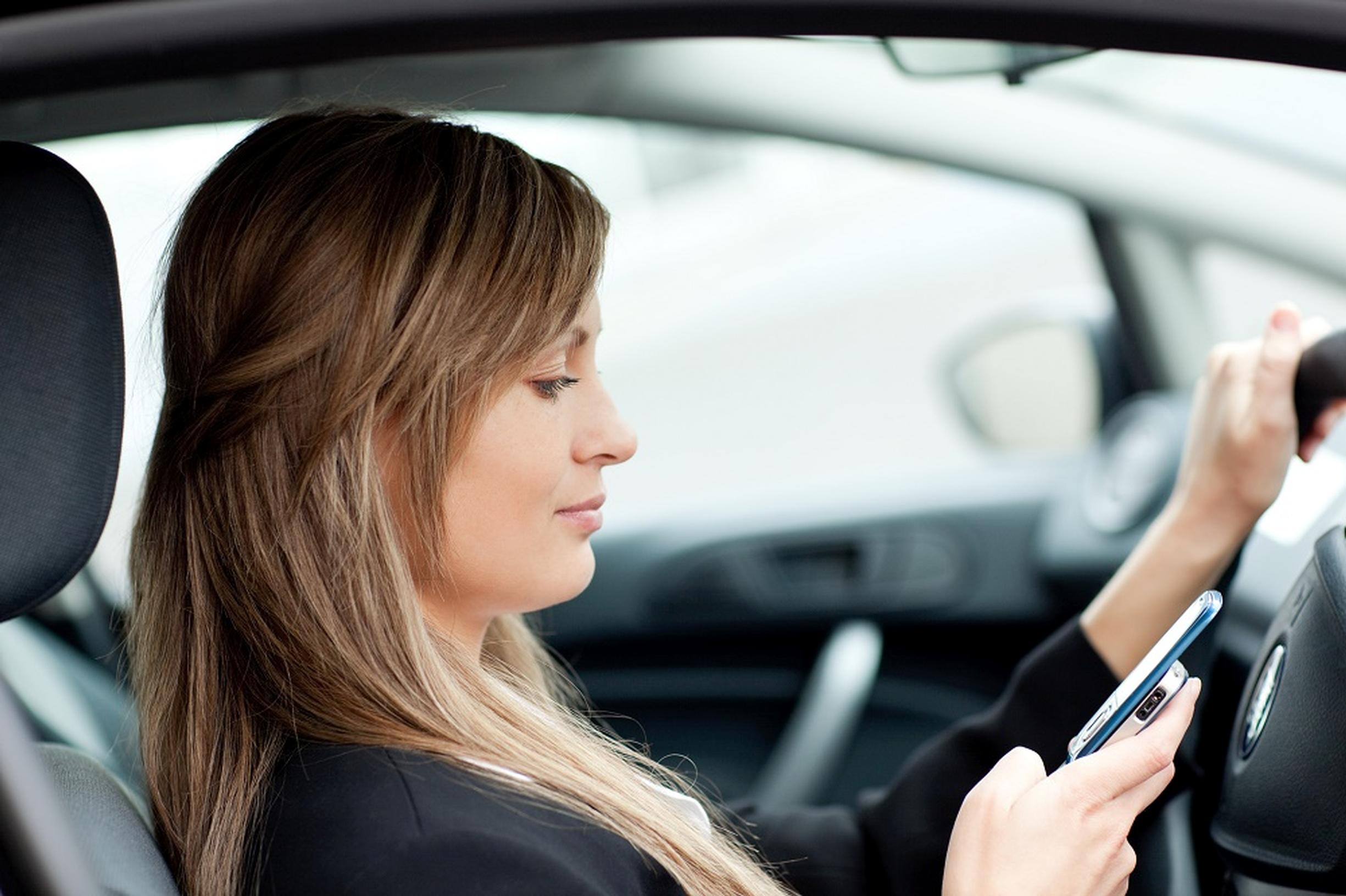 "The number of drivers who thought it acceptable to make a ""quick call"" on a handheld device while driving has doubled to 14%, says the RAC"