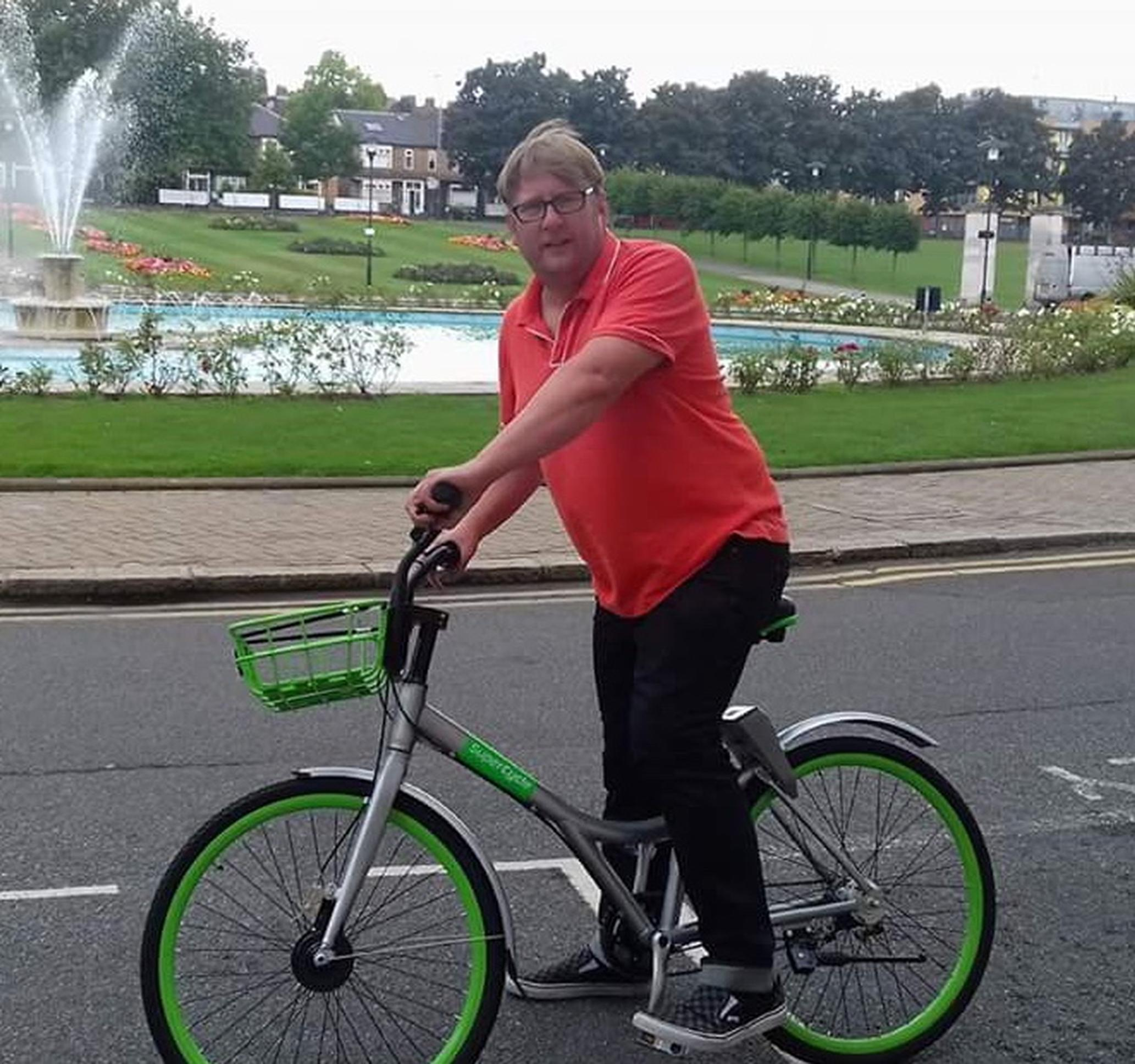 Waltham Forest`s member for the environment Clyde Loakes tries out an Urbo bike