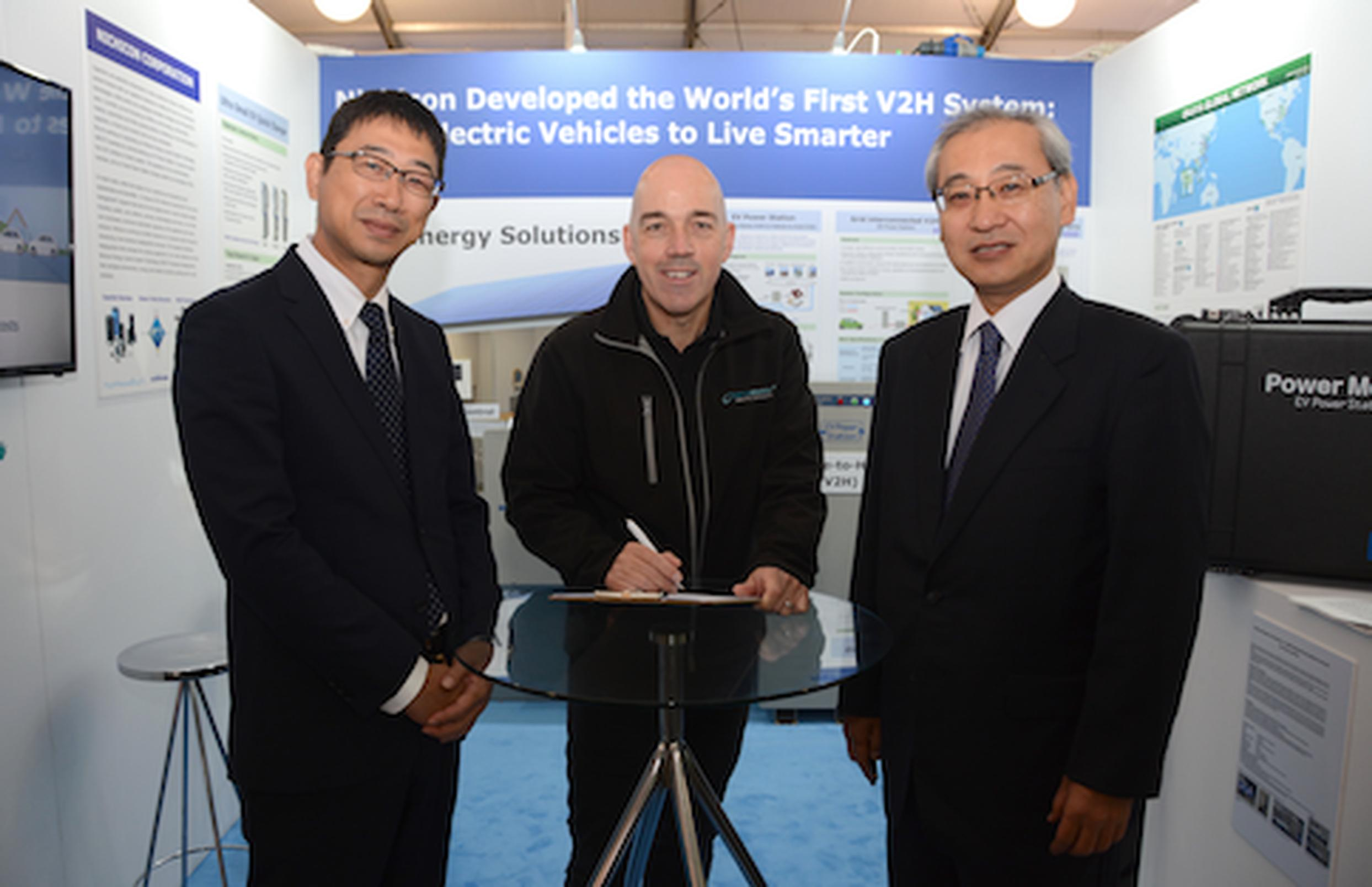 Mike Potter from DriveElectric signing a MOU for V2G chargers with Masahiro Ishiyama, senior general manager, and Hiroshi Seki, business group leader, Nichicon Corporation at LCV2017