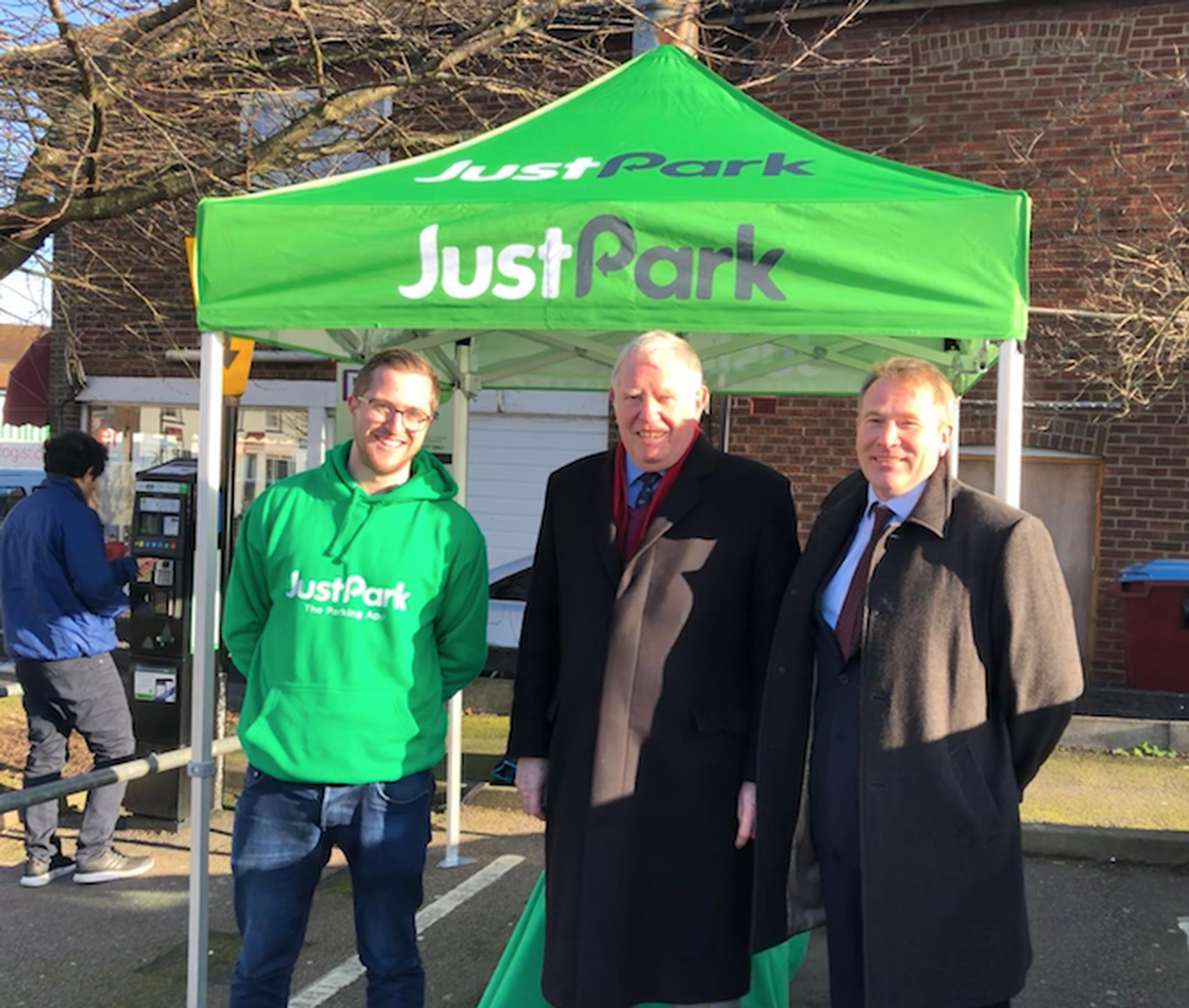 Sam Mellor and Gavin Manger of JustPark flank Central Bedfordshire Council Cllr Budge Wells