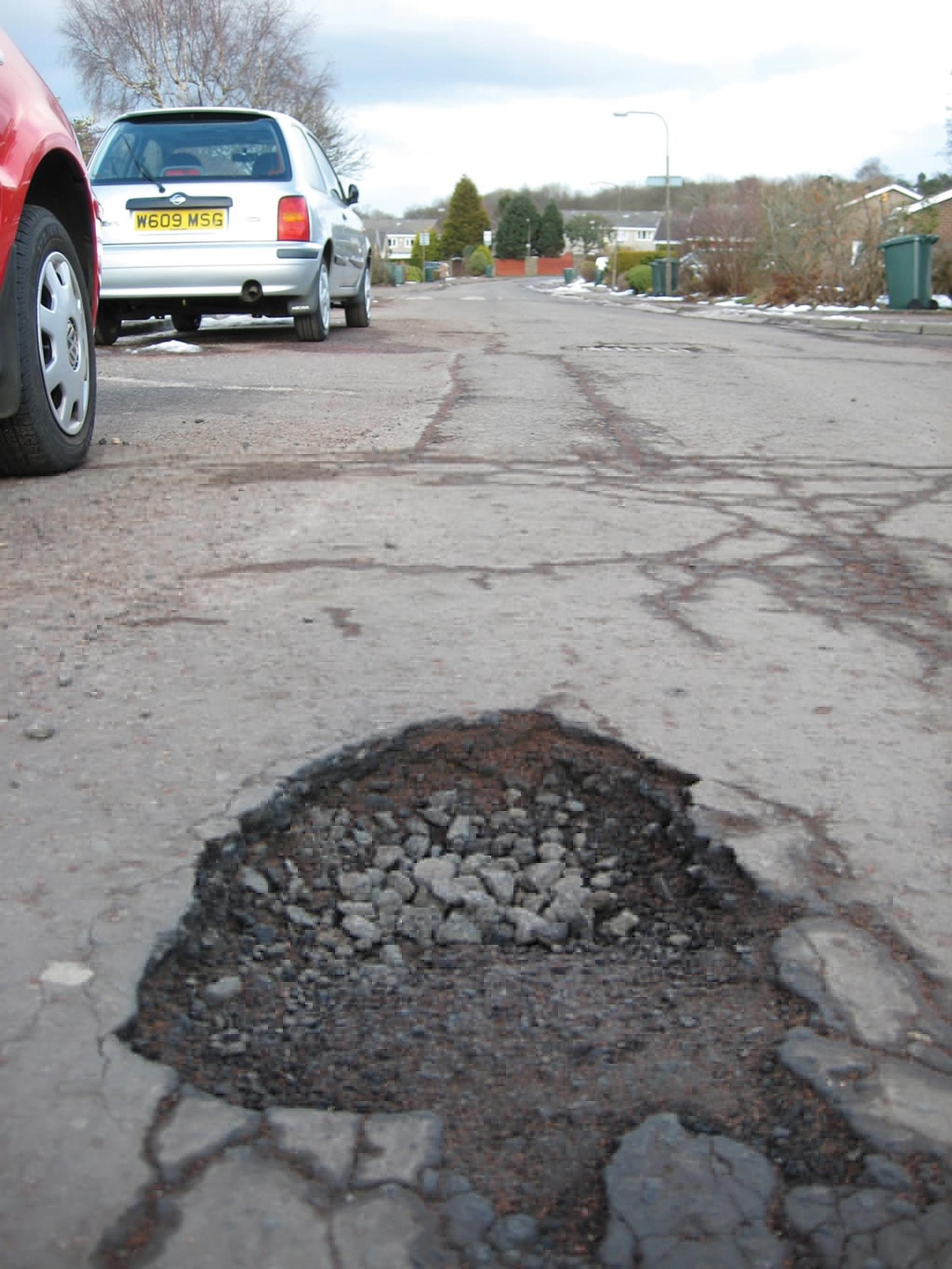 Councils could do more to repair roads and fill potholes if the government reinvested 2 pence per litre of fuel duty into local road maintenance, suggests the LGA