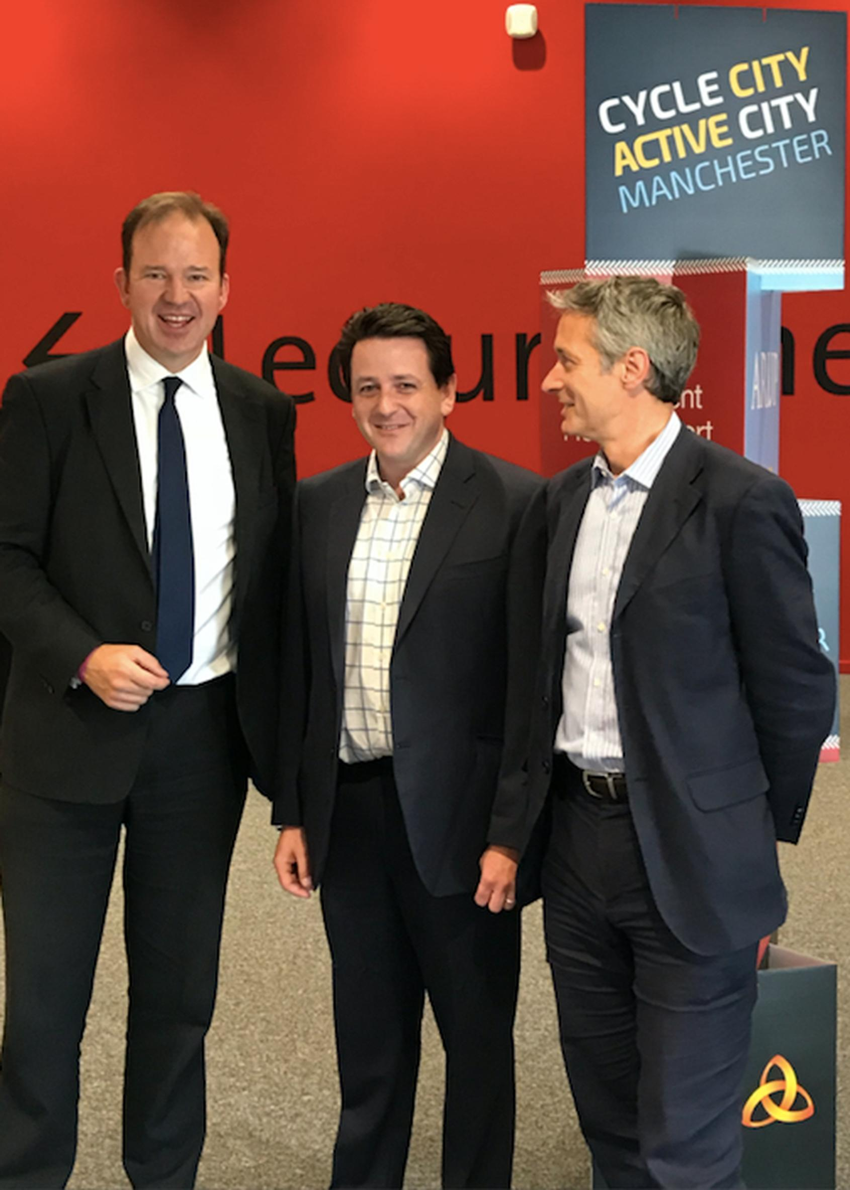 From left: transport minister Jesse Norman, Halfords` James Arnold, and Paul Robison of The Bikeability Trust at Cycle City Active City