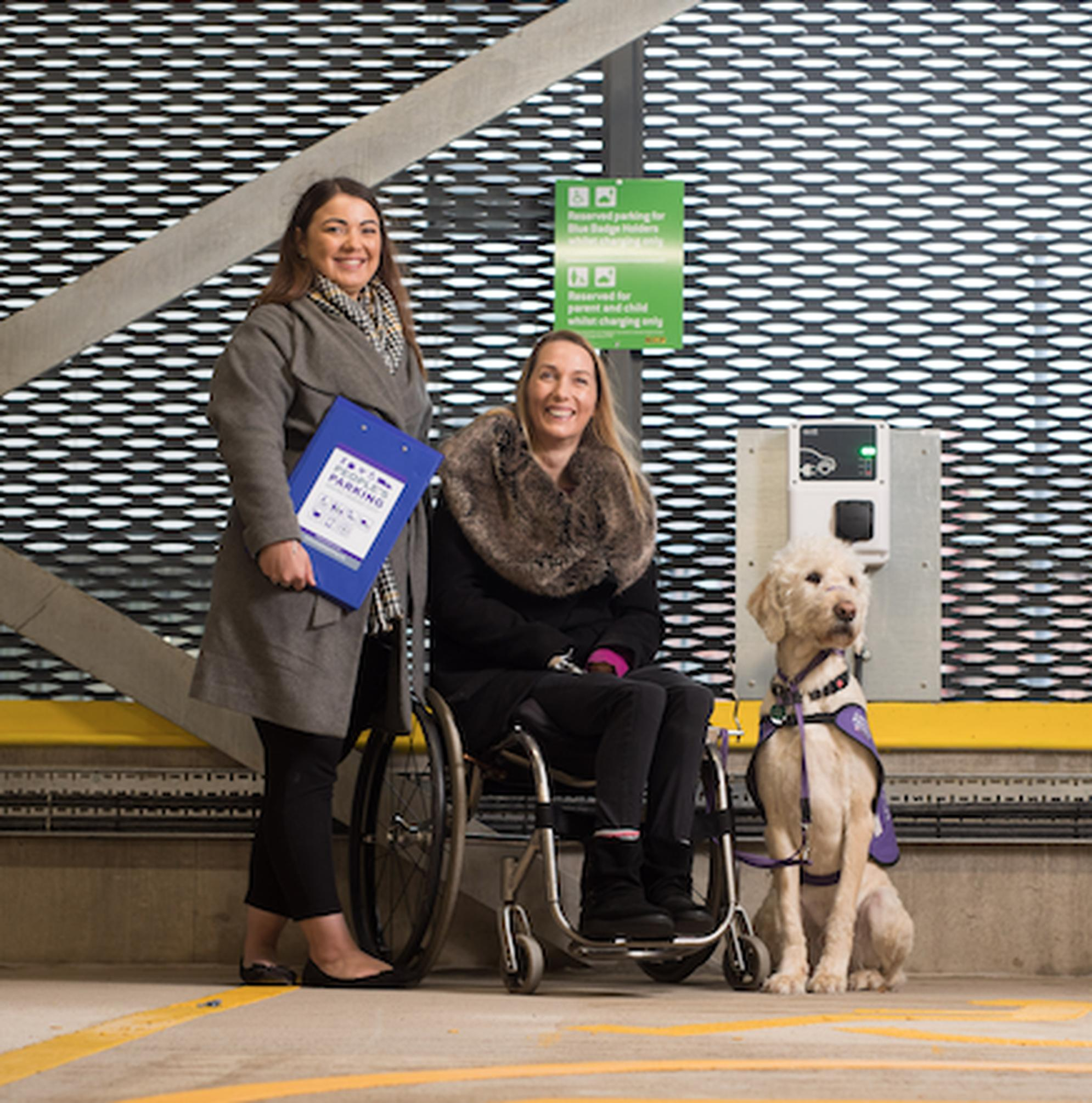 Libbie Bilyard and Helen Dolphin MBE, founders of the People's Parking accreditation scheme, with Fairport the assistance dog