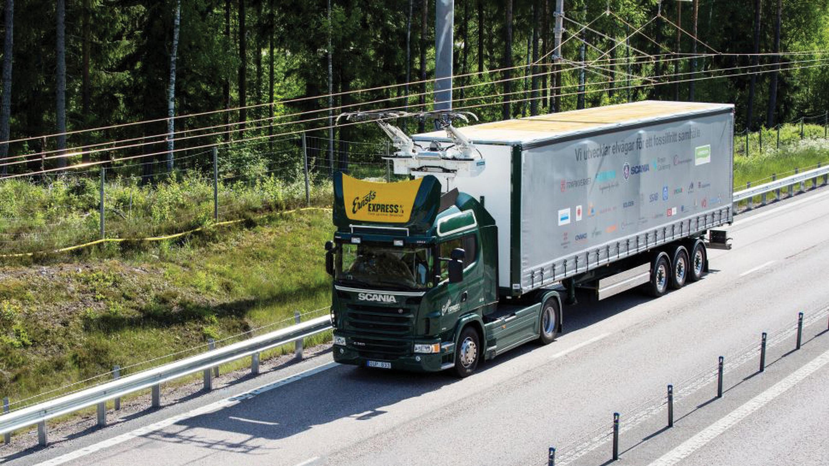 Trials abroad are using overhead wires to charge hybrid lorries