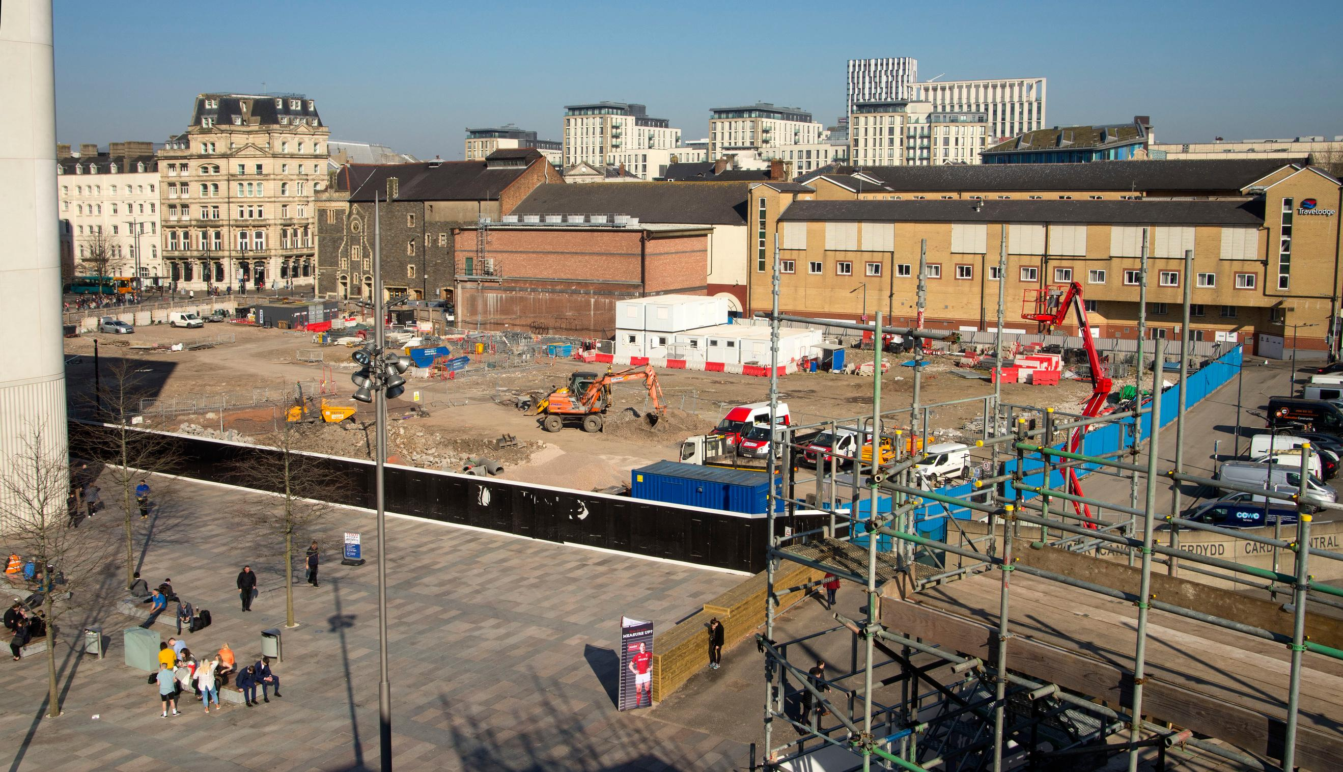 Viewed from the roof of Cardiff Central railway station, the site of the future bus station is behind the hoardings. The previous bus station, closed in 2015, was left of the picture
