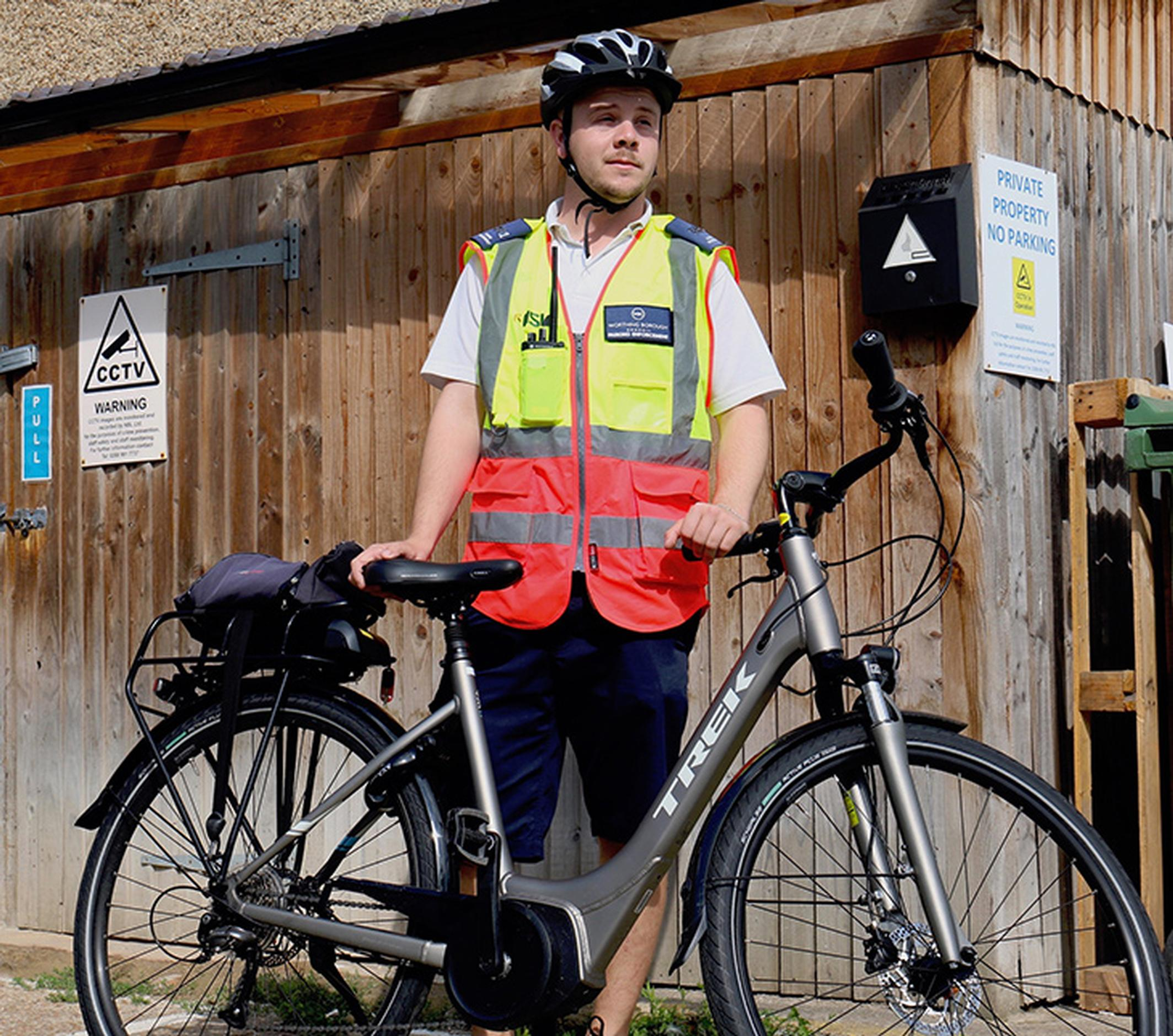 An NSL civil enforcement officer on an e-bike
