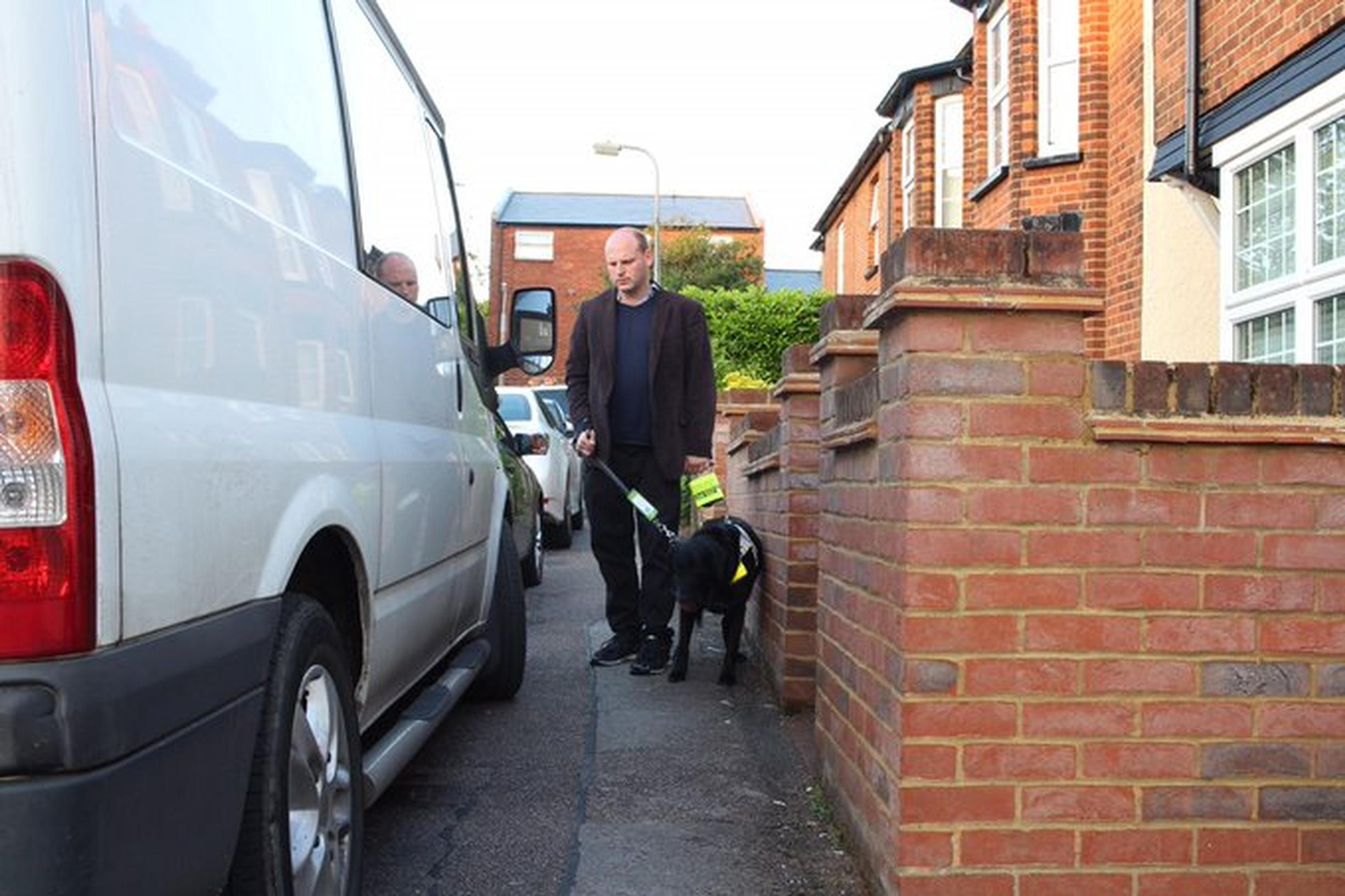 Cars parked on the footway are an obstruction for blind people