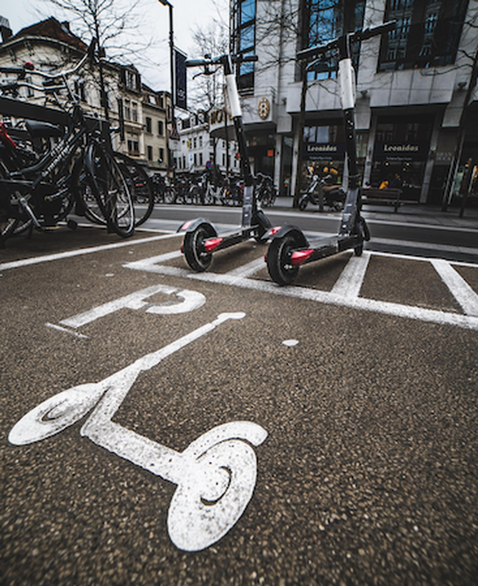 E-scooters are already common in Europe, with Antwerp in Belgium providing formal parking spots (Mika Baumeister/Unsplash)