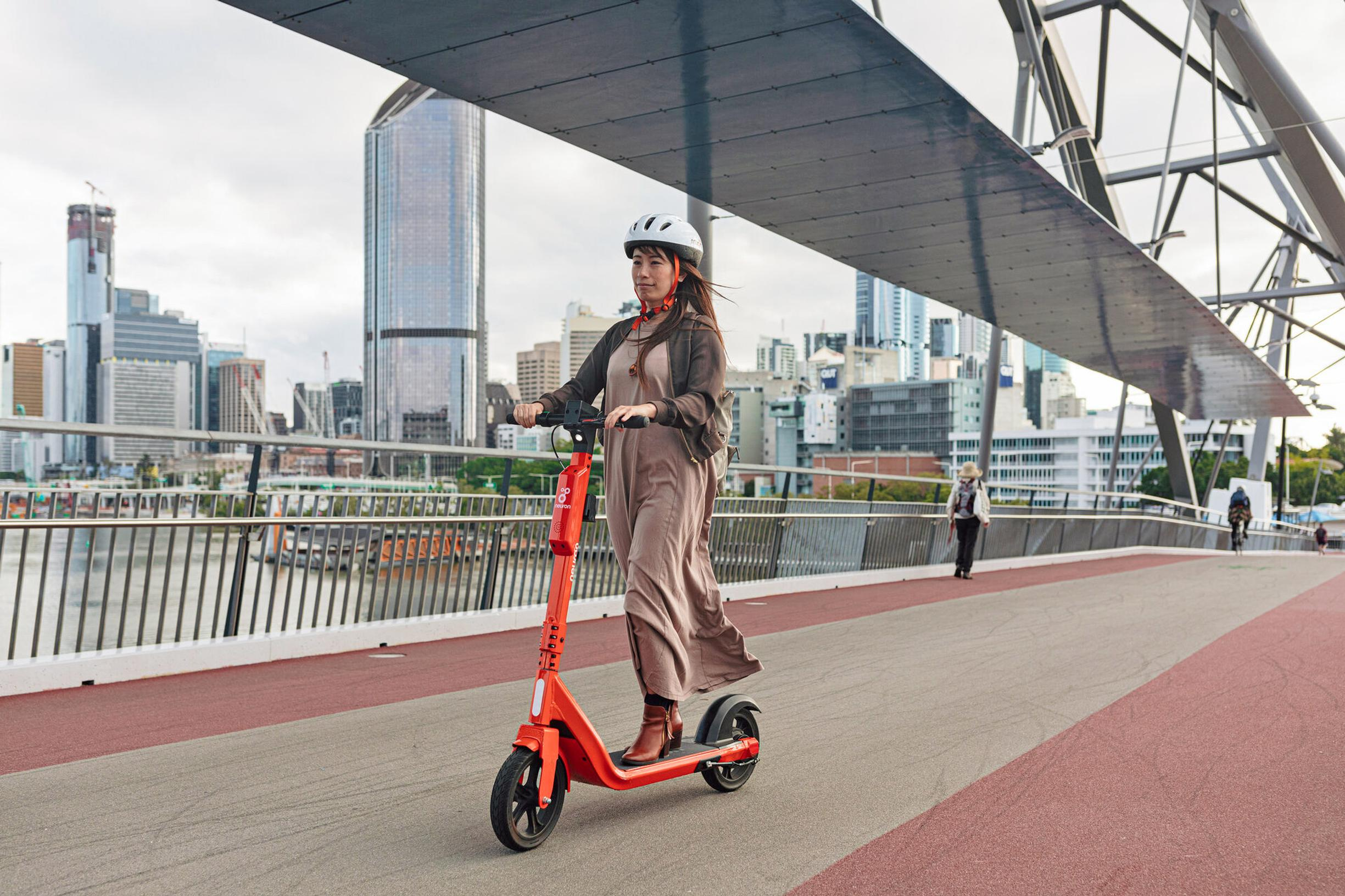 Neuron's e-scooters feature larger wheels and a unique helmet lock