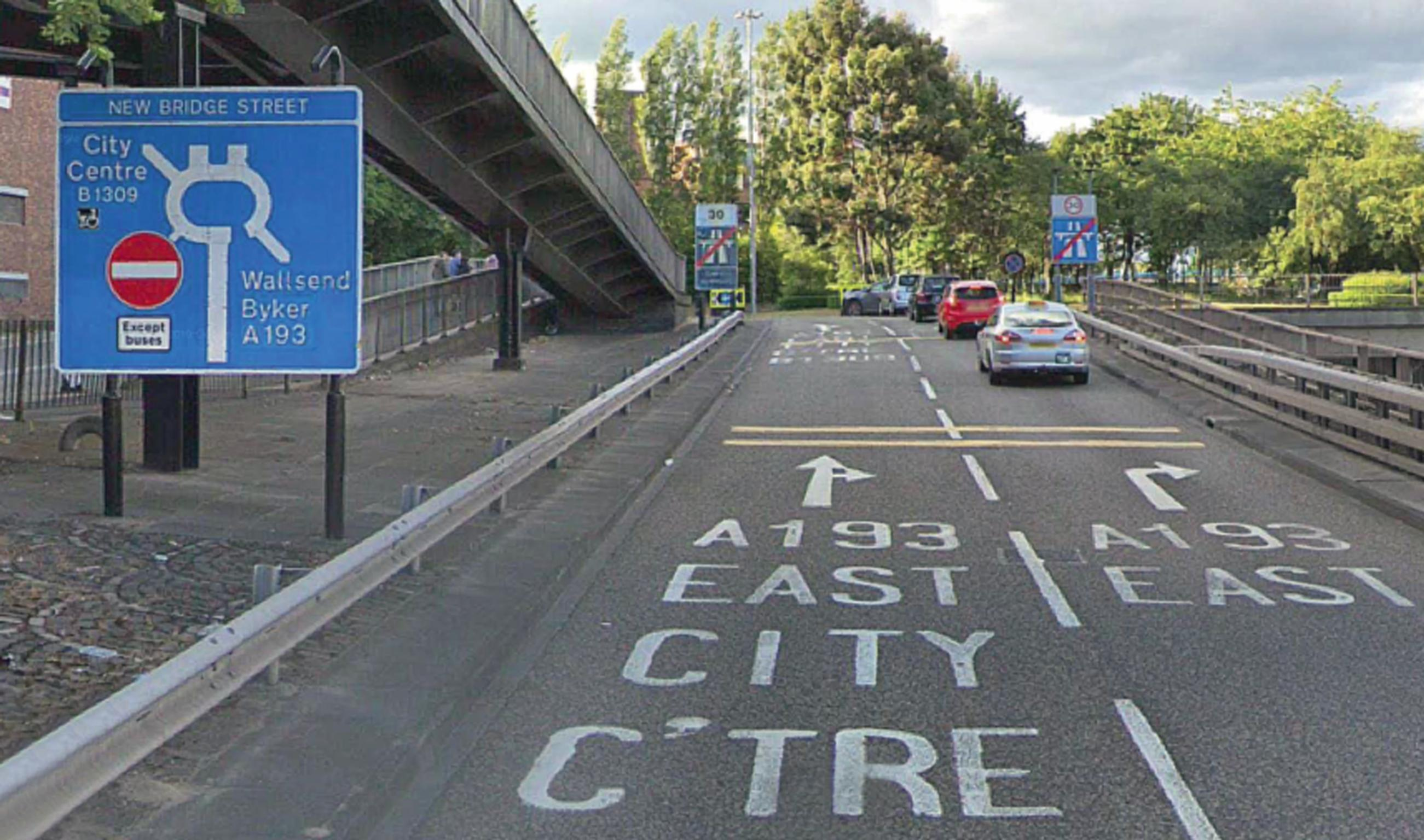 Image from the Traffic Penalty Tribunal's chief adjudicator's report: A driver's view when heading north on the slip road off the A167(M) approaching the roundabout with a sign indicating 'City Centre B1309', accompanied by Shopmobility graphic (Google Street View, June 2018)