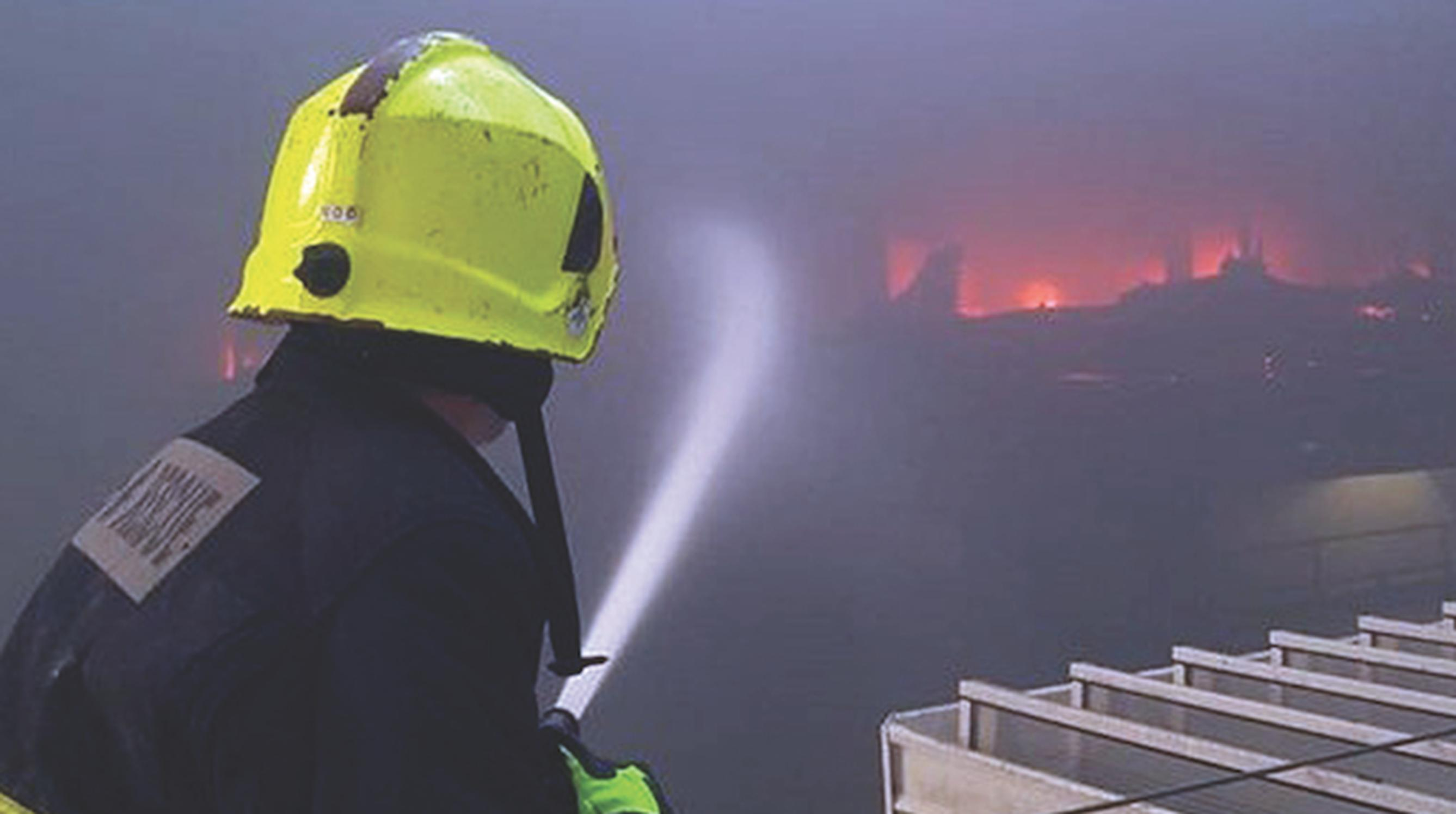 A fire fighter tackles a blaze at a car park in Cork in 2019 (Cork Fire Service)