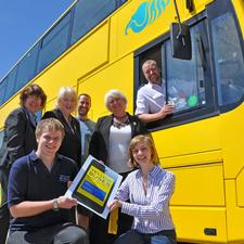 Staff from Yellow Buses and Base Creative Agency launch the new mobile phone journey planner app at the company's Bournemouth depot.